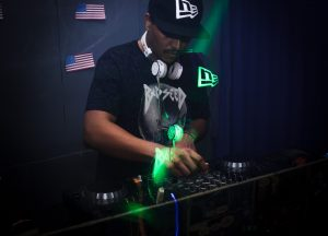 Man playing dj mixer